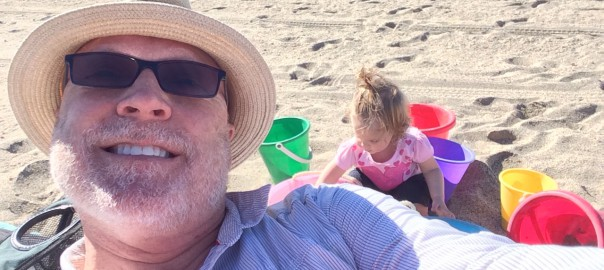 Grandpa and Kaylee selfie at the beach
